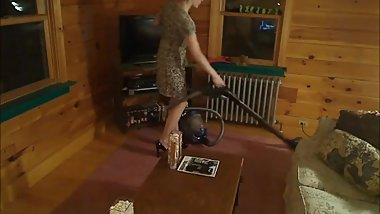 A good wife vacuuming her living room with a vacuum cleaner